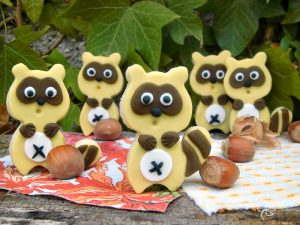 raccoon decorating cookies